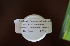 Label affixed to bottom of container shown above. Lists date of purchase.